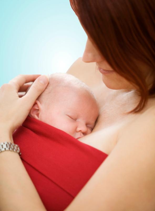 Newborn Held In Kangaroo Care