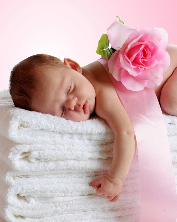 Newborn Sleeping on Towels